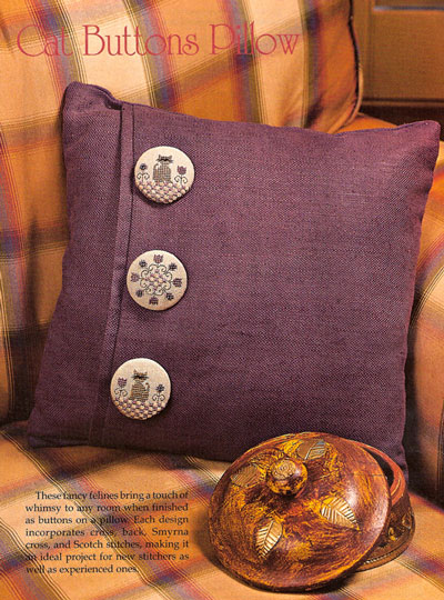 cat buttons on pillow